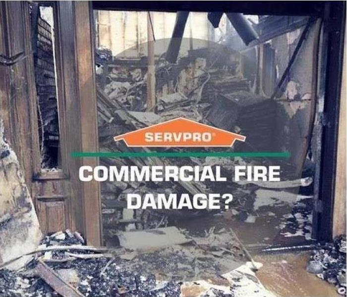 Completely burned out interior of a commercial building with SERVPRO logo and COMMERCIAL FIRE DAMAGE? superimposed on image